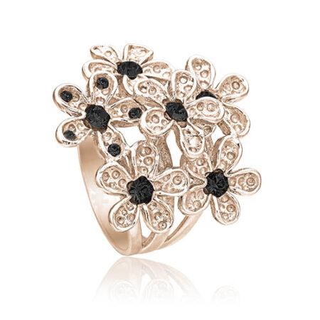 Priesme ring i rosa sølv med stor blomst