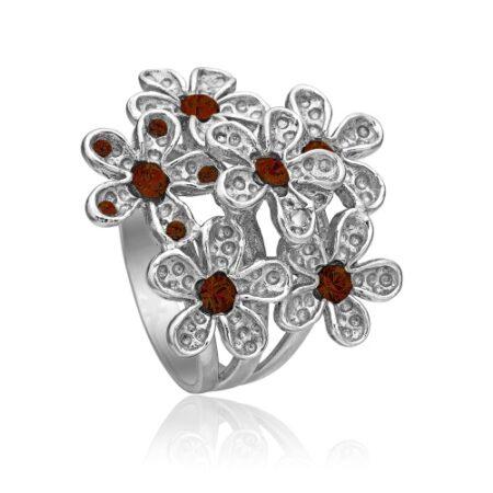 Sølv ring med blomster og røde krystaller